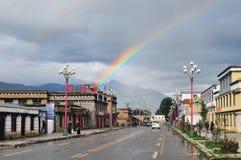 Tibetan town and rainbow Stock Image