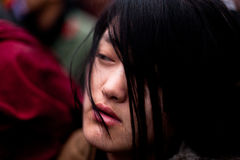 Tibetan victim. Tibetan actress staging a victim of Chinese repression. Paris, France. March 10th, 2012 Stock Images