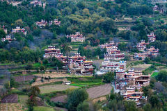 Tibetan village. The Tibetan village built on the hillside on the steep,forming a beautiful landscape Stock Image