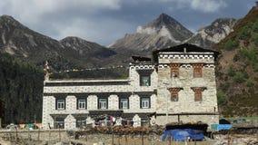 Tibetan village house, Yading, Sichuan Stock Photo