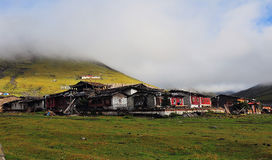 Tibetan village. In the morning, surrounded by a lot of fog Royalty Free Stock Photos