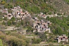 Tibetan village scene. A tibetan village located on a mountain slope Stock Image