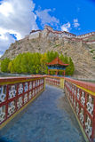 Tibetan walkway and fortress. A walkway in Tibet to and old fortress Royalty Free Stock Images