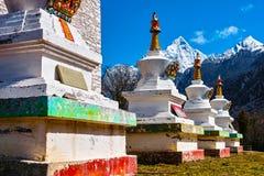 Tibetan white towers at Four Girls Mountain Stock Image