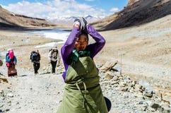 Tibetan woman commits bark around Mount Kailash. Royalty Free Stock Photography
