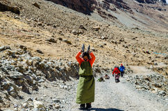 Tibetan woman commits bark around Mount Kailash. Stock Images