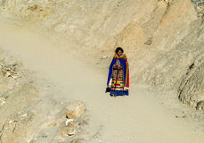 Tibetan woman commits bark around Mount Kailash. Stock Photography