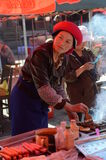 Tibetan woman cooking stock images