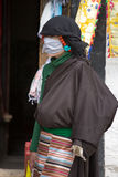 Tibetan woman dressed with traditional clothes in Lhas, Tibet. Stock Photo