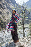 Tibetan woman in Himalaya Mountains Stock Photo
