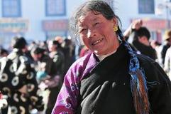 Tibetan woman. Pilgrims in the Jokhang Temple in Lhasa Stock Photos