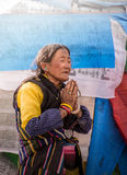 A Tibetan woman prays stock photo