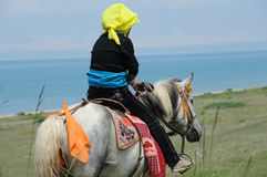 Tibetan woman riding horse Royalty Free Stock Image