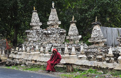 Tibetan woman,Sitting in front of the pagoda Royalty Free Stock Photo