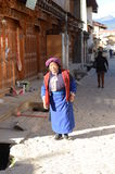 Tibetan woman walking in old town Stock Images