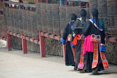 Tibetan women turning prayer wheels Royalty Free Stock Images