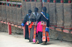 Tibetan women turning prayer wheels Royalty Free Stock Image
