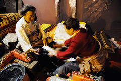 Tibetan workers printing an sutras Stock Photos