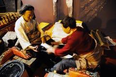 Tibetan workers printing an sutras.  Stock Photos