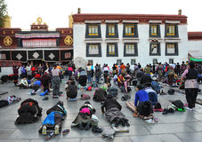 Tibetan worshippers from all over Tibet pray in front of their holiest temple Royalty Free Stock Photo