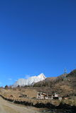 Tibetan yard and Yaomeifeng peak. Sichuan,  China Royalty Free Stock Photography