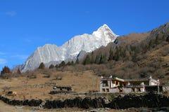 Tibetan yard and Yaomeifeng peak. Sichuan,  China Royalty Free Stock Image