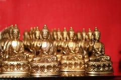 Tibetanische Buddha-Ansammlung für Gebet Stockfotografie