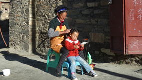 Tibetanische Mutter und Tochter Stockfotos