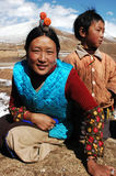 Tibetans. Portrait of a Tibetan woman and her son on the highlands of Tibet.Used for news and articles about the people and traveling in Tibet Royalty Free Stock Photos