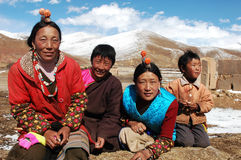 Tibetans. Family members on the highlands of Tibet.Used for news and articles about the traveling and situation in Tibet Royalty Free Stock Image