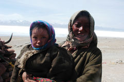 Tibetans. Portraits of a Tibetan woman with her son on the highlands of Tibet.Used for news and articles about the people and traveling in Tibet Royalty Free Stock Photos