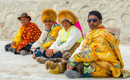 Tibetans in festive clothes. Tibet. Men in festive clothes on holiday. Look festive presentation Royalty Free Stock Photo