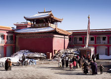 Tibetans leaving monastery Stock Image
