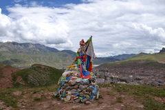 Tibetans prayer flags and praying(mani) stones stock images