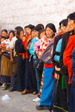 Tibetans Queue Enter Jokhang Temple Lhasa. LHASA, CHINA - OCTOBER 17, 2007: Unidentified Tibetans in traditional clothes queue to enter Jokhang temple, a famous Stock Photography