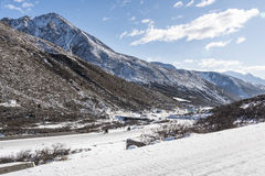 Tibetans to ride a motorcycle. In Zheduo mountain after snow.This photo was taken in Zheduo mountain,Ganzi Prefecture,Sichuan province,china Stock Photos
