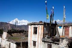 Tibetian house and snow mountains Stock Photo