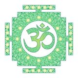 Tibetian openwork mandala, elegant circular ornament with the Om / Aum / Ohm sign in the middle on a green background. royalty free stock image