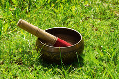 Tibetian singing bowl with wooden stick. Royalty Free Stock Photos