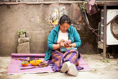 Tibetian woman with a smartphone, India Royalty Free Stock Photography
