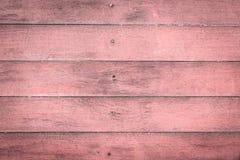 tic doorstane schuur oude roze houten achtergrond met knopen en spijker Royalty-vrije Stock Afbeelding