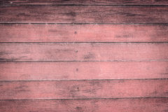 tic doorstane schuur oude roze houten achtergrond met knopen en spijker Stock Afbeelding