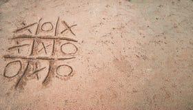 Tic-TAC-dedo del pie en la arena Fotografía de archivo