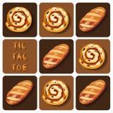 Tic-TAC-dito del piede del rotolo di cannella e del pane Fotografia Stock