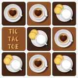 Tic-TAC-dito del piede di latte e di cappuccino Immagine Stock