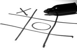 Tic-TAC-dito del piede su una superficie bianca Fotografia Stock Libera da Diritti