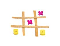 Tic Tac Toe. Wooden tic tac toe game isolated on a white background Royalty Free Stock Photo