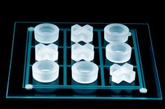 Tic Tac Toe. Glass Tic Tac Toe set Royalty Free Stock Photos