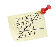 Tic tac toe. Thumb tacked note with game of tic tac toe Stock Image