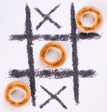 Tic-tac-toe with bagels. A tic-tac-toe game with bagels and poppy-seed Royalty Free Stock Photo